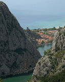 Omis , Dalmatia, Croatia. Omiš - city in Croatia . On one place you can see circuit of mountain,  delta of river and sea and old fortress - Fortica. Vertical Royalty Free Stock Photography