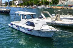 Boats at the marina in the town of Omis, Croatia. stock photos