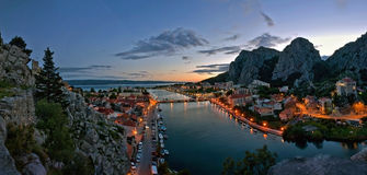 Omis in the twilight 1. Beautiful panorama of Omis Riviera. Omis is a city that lying at the mouth of the Cetina River into the Adriatic Sea. It is surrounded by stock image