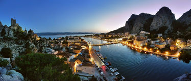 Omis in the twilight. Aerial view - twilight panorama of Omis Riviera. Omis is a city that lies at the mouth of the Cetina River into the Adriatic Sea. It is royalty free stock photos