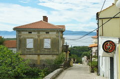 Omisalj, Croatia. – September 19, 2016: a town situated on the northern coast of the island of Krk. The streets in the old town with buildings typical for the Stock Photography