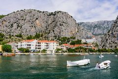 Boats on the Cetina river in Omish town stock photos