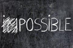 Omöjligt blir möjligt på den svart tavlan Arkivfoton