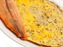 Omlette avec le déjeuner de poissons Photos stock