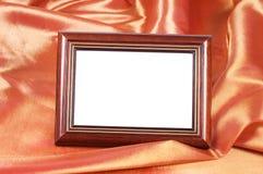 Omlijstingen op de achtergrond van het kleurensatijn Stock Foto's