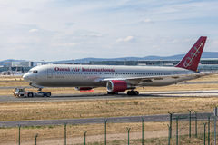 Omni Air International Boeing 767-300 ER. FRANKFURT, GERMANY - JULY 26: Omni Air International Boeing 767-300 ER at the Frankfurt International Airport (FRA) royalty free stock images