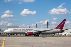 Omni Air International Boeing 767-300ER. FRANKFURT - SEP 11: Omni Air International Boeing 767-300ER aircraft at the Frankfurt International Airport. September royalty free stock photos