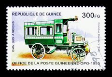 Omnibus Daimler - 1898, Historic Buses serie, circa 1995. MOSCOW, RUSSIA - MARCH 18, 2018: A stamp printed in Republic of Guinea shows Omnibus Daimler - 1898 Royalty Free Stock Photos