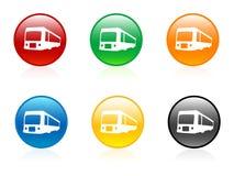 Omnibuses en botones Fotografía de archivo