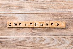 OMNICHANNEL word written on wood block. OMNICHANNEL text on wooden table for your desing, concept royalty free stock photos