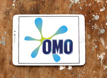 Omo laundry detergent logo. Logo of omo laundry detergent or washing powder on samsung tablet on wooden background Stock Photo