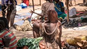 Unidentified woman with her back with tatoos from Hamar tribe at local village market in Ethiopia. Omo Valley, Ethiopia - September 2017: Unidentified woman with Stock Photography