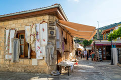 OMODOS, CYPRUS - OCTOBER 4, 2015: Traditional souvenir shops wit Stock Photography