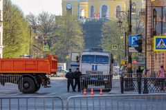 OMON truck for detained citizens. St. Petersburg, Russia - May 01, 2019: Car riot police and police at the intersection. Overlap and protection of streets during royalty free stock photos