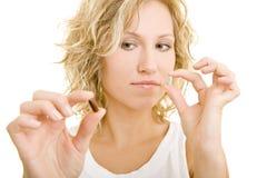Omparing Pillen Lizenzfreies Stockbild