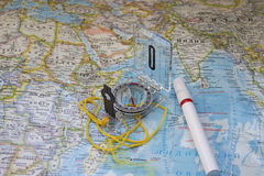 Сompass and a marker on a world map. Tourism or traveling concept Stock Photography