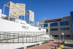 Område för byggnadsrestaurangport i El Grao, maritimt område Cas royaltyfria foton