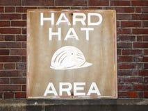 Områdestecken för hård hatt Arkivfoto