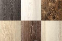 Området av fyrkanten för bakgrund för closeup för textur för utomhus- laminat för grupp den wood royaltyfri bild