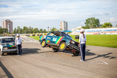 Omsk, Russia - August 03, 2013: Auto rodeo, car stunts Royalty Free Stock Image