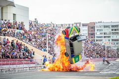 Omsk, Russia - August 03, 2013: Auto rodeo, car stunts. Omsk, Russia - August 03, 2013: Auto rodeo car stunts - car jump on fire Stock Photo