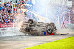Omsk, Russia - August 03, 2013: Auto rodeo, car stunts. Omsk, Russia - August 03, 2013: Auto rodeo car stunts - car jump on fire Royalty Free Stock Images