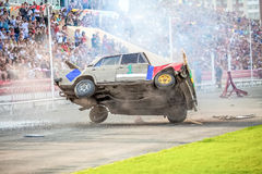 Omsk, Russia - August 03, 2013: Auto rodeo, car stunts. Omsk, Russia - August 03, 2013: Auto rodeo car stunts - car jump on fire Stock Image