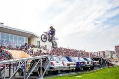 Omsk, Russia - August 03, 2013: Auto rodeo, stunts motorcycle Royalty Free Stock Photos