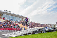 Omsk, Russia - August 03, 2013: Auto rodeo, stunts motorcycle Royalty Free Stock Image