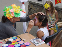 Omsk, Russia - August 03, 2014: face painting process outdoor Royalty Free Stock Images