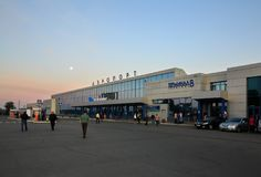 Omsk airport building in the early morning. Omsk, Russia - August 22, 2013: Omsk airport building in the early morning Stock Photo