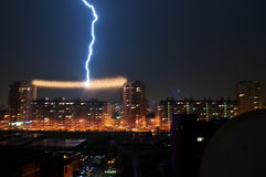 OMSK, RUSSIA - August 7, 2012: Thunderstorm in the city, lightning struck in the power line between the houses Stock Image