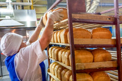 Omsk, Russia - December 19, 2014: Workers At Bread Factory Royalty Free Stock Images