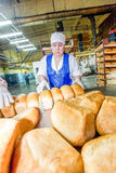 Omsk, Russia - December 19, 2014: Wokers at bread factory Royalty Free Stock Photo