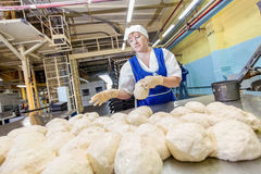 Omsk, Russia - December 19, 2014: Wokers at bread factory Royalty Free Stock Photography