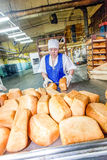 Omsk, Russia - December 19, 2014: Workers at bread factory Royalty Free Stock Photography
