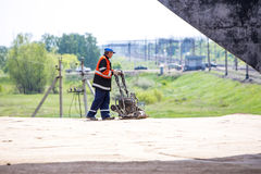 Omsk, Russia - June 2: road worker. Construction on June 2th 2015 Stock Image