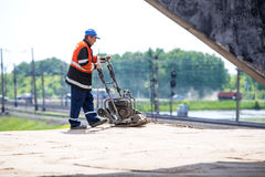 Omsk, Russia - June 2: road worker. Construction on June 2th 2015 Royalty Free Stock Photos