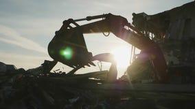 Machine works with debris at demolition site of old arena
