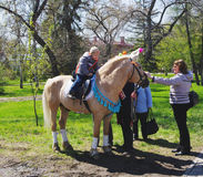 OMSK, RUSSIA - MAY 09, 2015: children's horse riding on pony Royalty Free Stock Photography