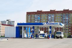 OMSK, RUSSIA - MAY 26, 2015: Petrol station in city boundaries. OMSK, RUSSIA - MAY 26, 2015: Petrol station in city microdistrict Royalty Free Stock Photo