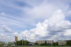 OMSK, RUSSIA - MAY 16, 2009: Scenic sky in clouds above city. OMSK, RUSSIA - MAY 16, 2009: Picturesque spring sky in cumulus clouds above panorama of town Stock Image