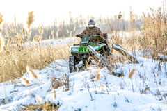 Omsk, Russia - November 13, 2015: quad bike in field Royalty Free Stock Images