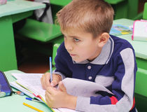Omsk, Russia - September 24, 2011: schoolboy at school desk closeup Royalty Free Stock Photos