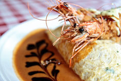 Omurice with king prawns Stock Photo