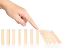 Omvergeworpen de domino's ononderbroken van het handeinde Stock Foto's
