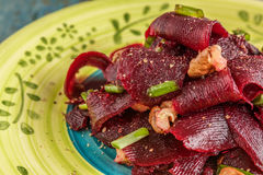 On A Bright Ethnic Plate Is A Vegetarian Lean Beet Salad, Green Stock Image