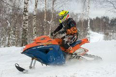 On A Snowmobile In The Winter Forest Royalty Free Stock Image