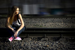 On Rails In Pink Gymshoes Royalty Free Stock Image