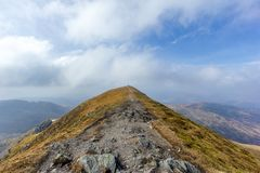 Free On The Way To The Summit Trig Point Of A Scottish Mountain Ben Vorlich With Rocky Path And Dry Grass Under A Majestic Blue Sky A Royalty Free Stock Photos - 145695428